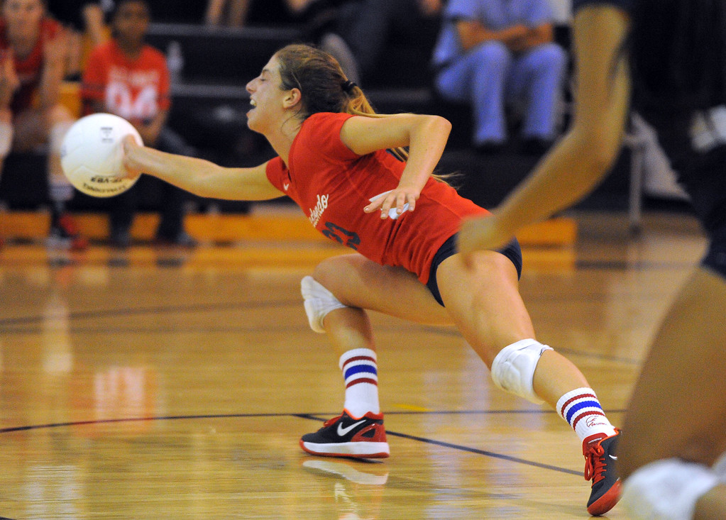 . Redondo girls volleyball takes on Bishop Montgomery in a non league match in Torrance on 09/10/2013. Redondo won 3-0. Redondo\'s Hayes Honea dives for a ball but is unable to reach it. (Photo by Scott Varley, Daily Breeze)
