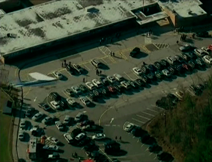 Description of . Police and emergency personnel set up in the parking lot after a shooting at Sandy Hook Elementary School in Newtown, Connecticut, December 14, 2012.  REUTERS/WNBC/Handout