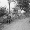 NJ920927K, Man marking Ordnance Survey minor control revision point with an arrow in 1950s