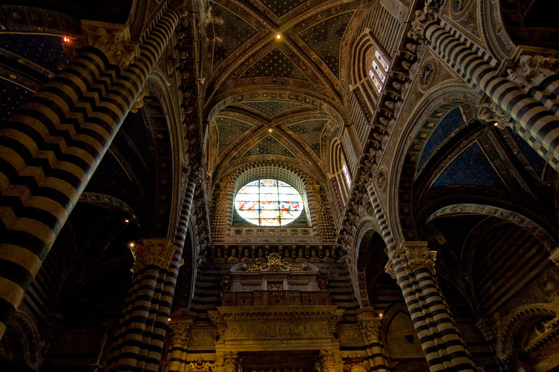 Looking up the pillars and ceiling of Cathedral of Pisa in Italy