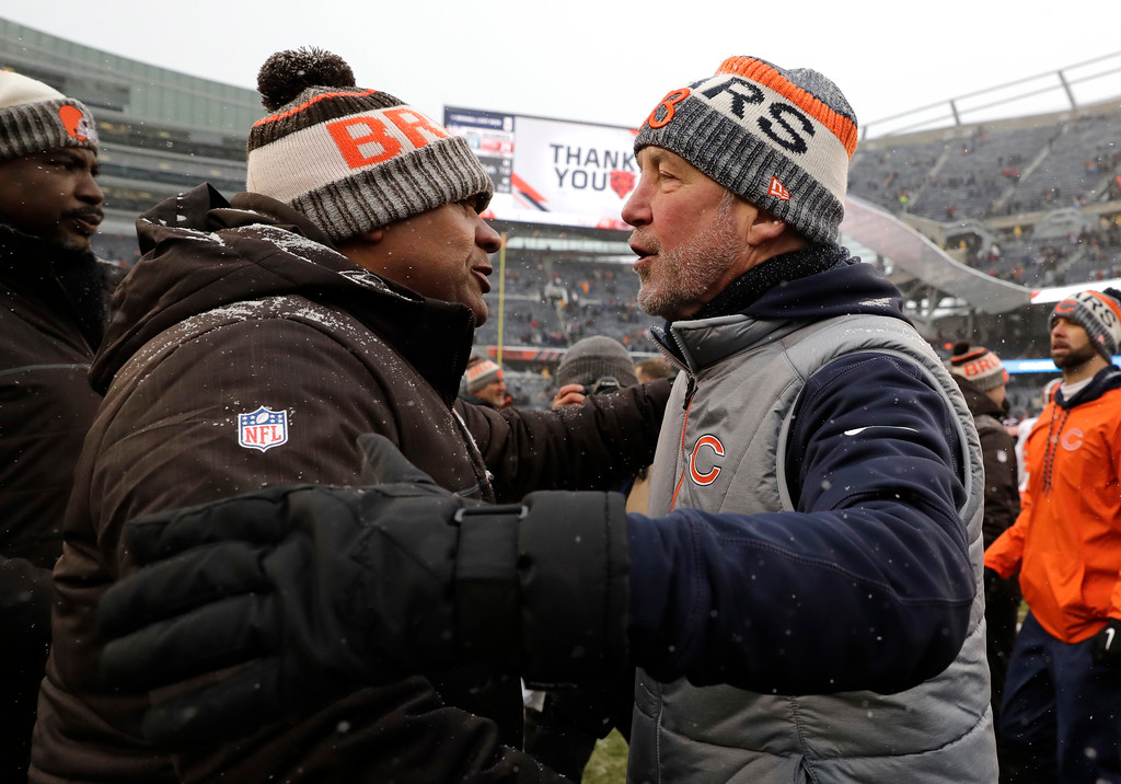 . Cleveland Browns head coach Hue Jackson, left, talks with Chicago Bears head coach John Fox after an NFL football game in Chicago, Sunday, Dec. 24, 2017. Chicago won 20-3. (AP Photo/Nam Y. Huh)