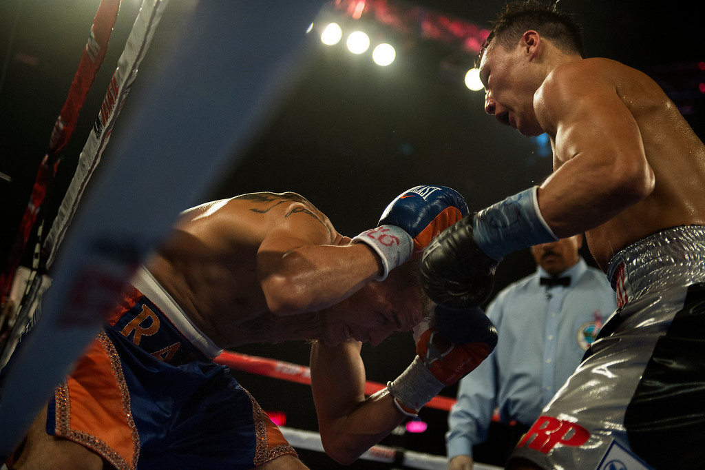 . BROOMFIELD, CO. - October 19: Mike Alvarado is beat to the ground for the second time after taking huge shots against Russian Ruslan Provodnikov in the 8th round at the 1st Bank Center October 19, 2013 Broomfield, Colorado. (Photo By Joe Amon/The Denver Post)