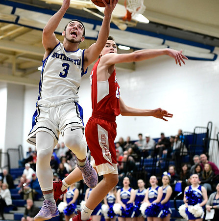 2/21/2019 Mike Orazzi | Staff Berlin High School's Jeffrey Madeia (20) and Southington's Colin Burdette (3) during the CCC Boys Basketball Tournament in Southington Thursday night.
