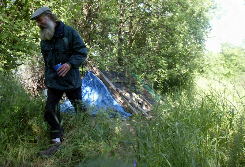 A man by the name of Steve walks away from his home that has been living in the property behind Otterson Dr. for the last couple of years.  - Halley photo 4/28/05