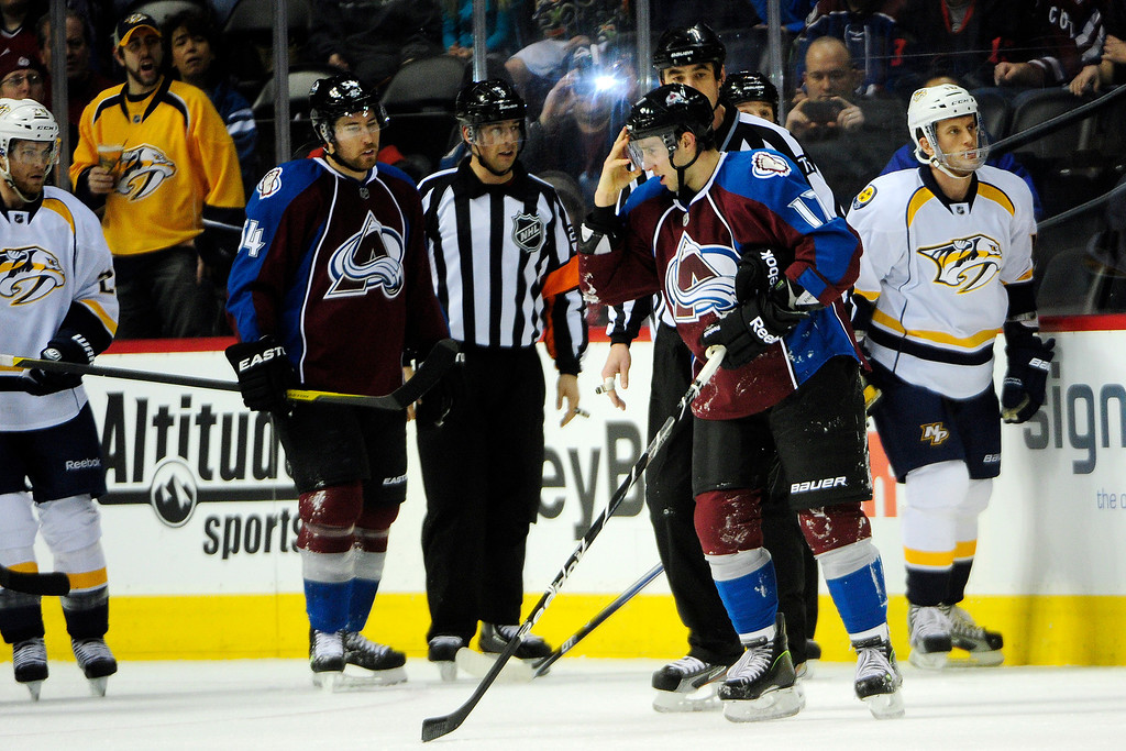 . Aaron Palushaj (17) of the Colorado Avalanche clears his helmet after being checked during the first period of action. The Colorado Avalanche take on the Nashville Predators at the Pepsi Center on February 18, 2013. (Photo By AAron Ontiveroz/The Denver Post)