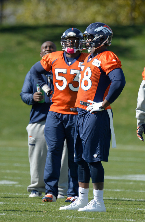 . Denver Broncos outside linebacker Von Miller (58) watches drills during his first day back to practice October 16, 2013 at Dove Valley. Miller just finished serving a six game suspension. (Photo by John Leyba/The Denver Post)
