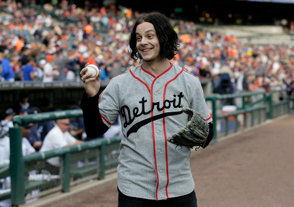 . Musician Jack White shows off a baseball before throwing out the ceremonial first pitch before the Detroit Tigers baseball game against the Chicago White Sox Tuesday, July 29, 2014, in Detroit. (AP Photo/Duane Burleson)