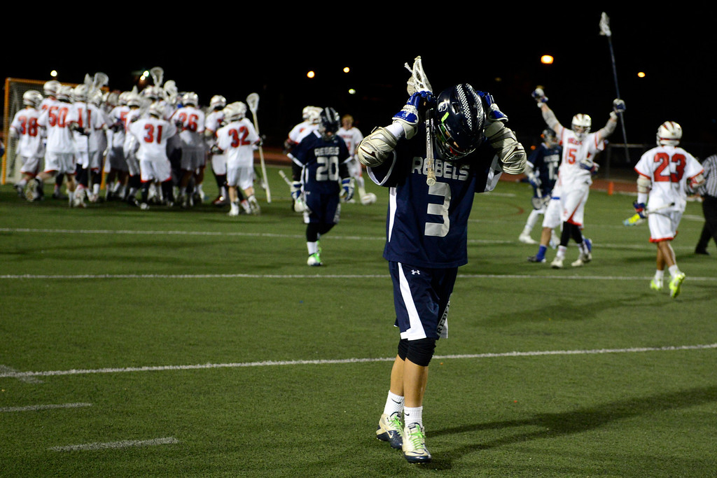 . Columbine\'s Landon Kramer reacts as Cherry Creek celebrates following Cherry Creek\'s 7-6 win.  (Photo by AAron Ontiveroz/The Denver Post)