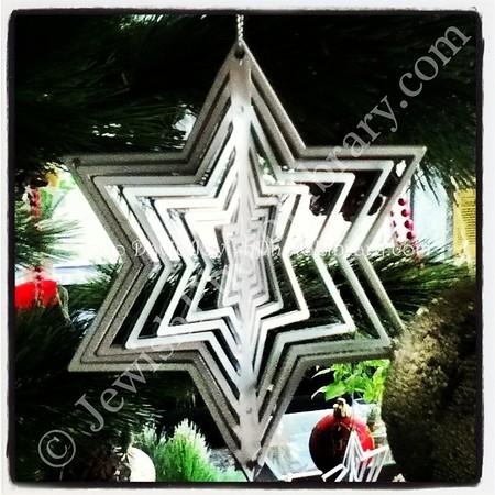 VIETNAM, Nha Trang. Hanukkah ornaments on a mixed holiday tree (Starlet Hotel lobby) (12.2013)