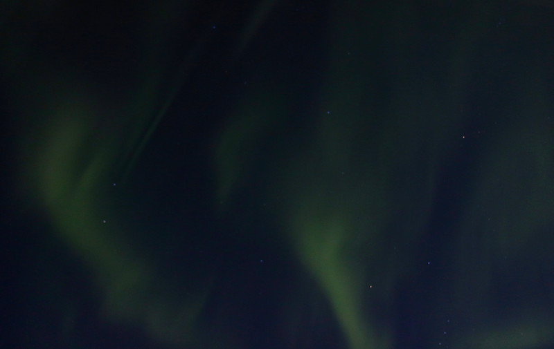 Aurora Borealis from tundra lodge parked near Hudson Bay