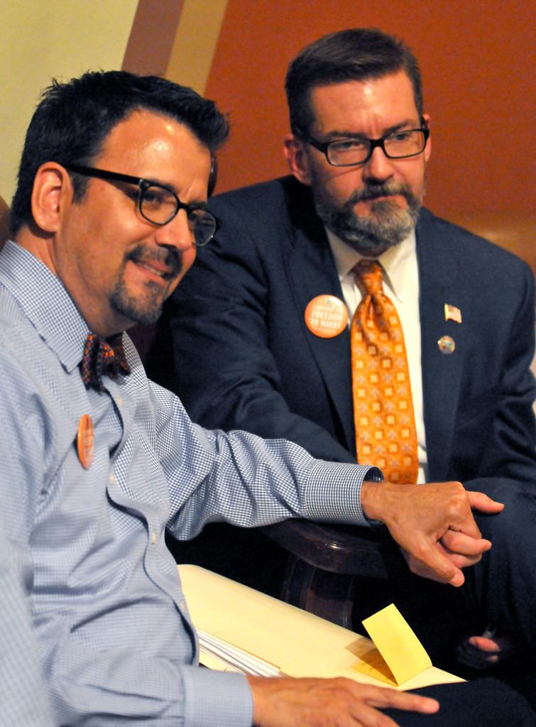 . Sen. Scott Dibble, left, and his partner, Richard Leyva, watch the House debate before the floor vote.  (Pioneer Press: John Doman)