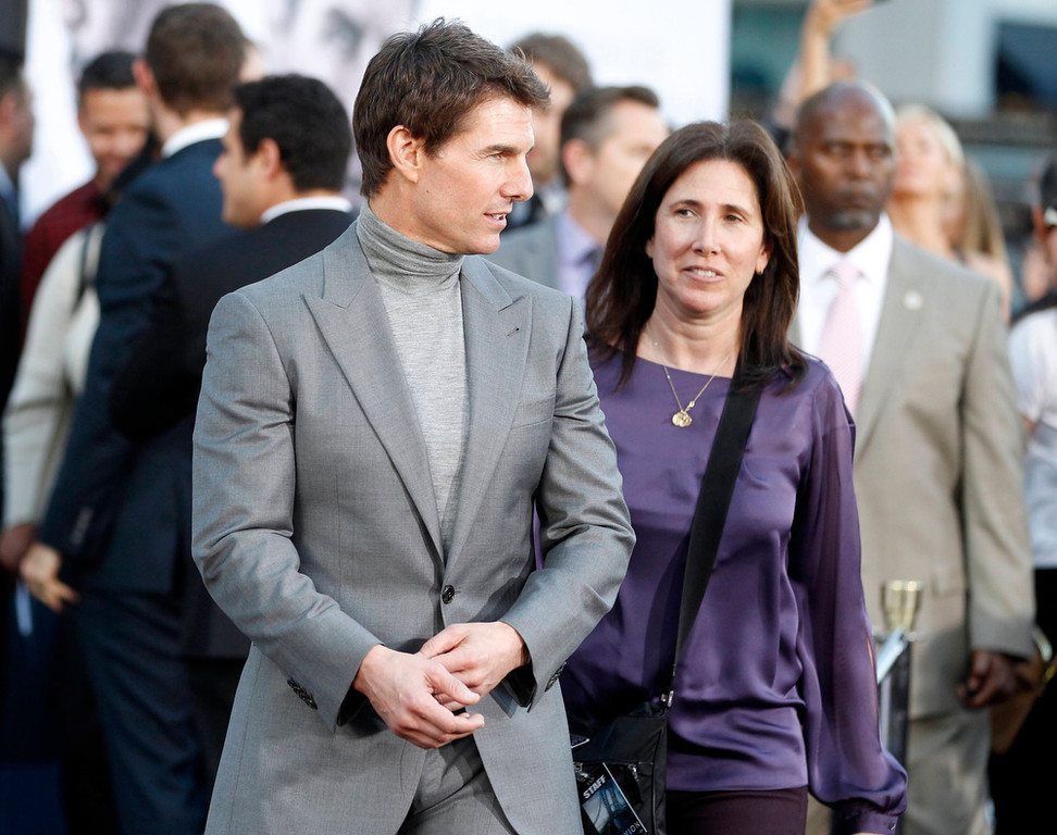 """. Actor Tom Cruise (L) poses at the premiere of his new film Oblivion\"""" with publicist Amanda Lundberg, at his side in Hollywood April 10, 2013.    REUTERS/Fred Prouser"""