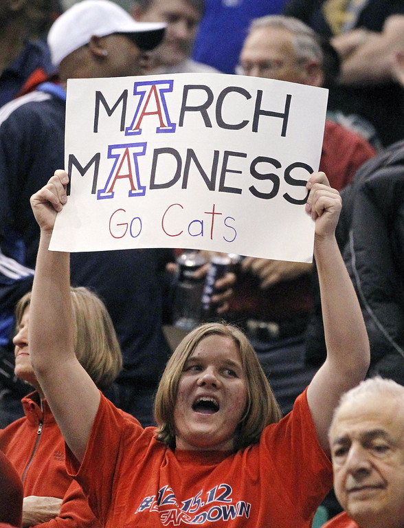 . An Arizona fan holds up a March madness sign during a second-round game against Belmont in the NCAA college basketball tournament in Salt Lake City Thursday, March 21, 2013. (AP Photo/Rick Bowmer)