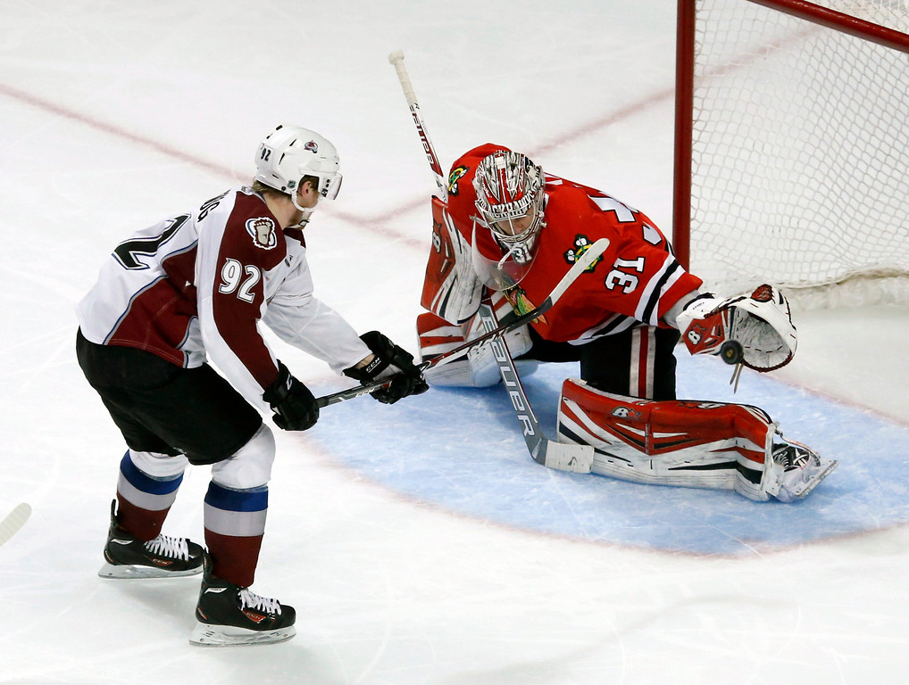 . Colorado Avalanche left wing Gabriel Landeskog (92) scores past Chicago Blackhawks goalie Antti Raanta during the third period of an NHL hockey game Friday, Dec. 27, 2013, in Chicago. The Blackhawks won 7-2. (AP Photo/Charles Rex Arbogast)