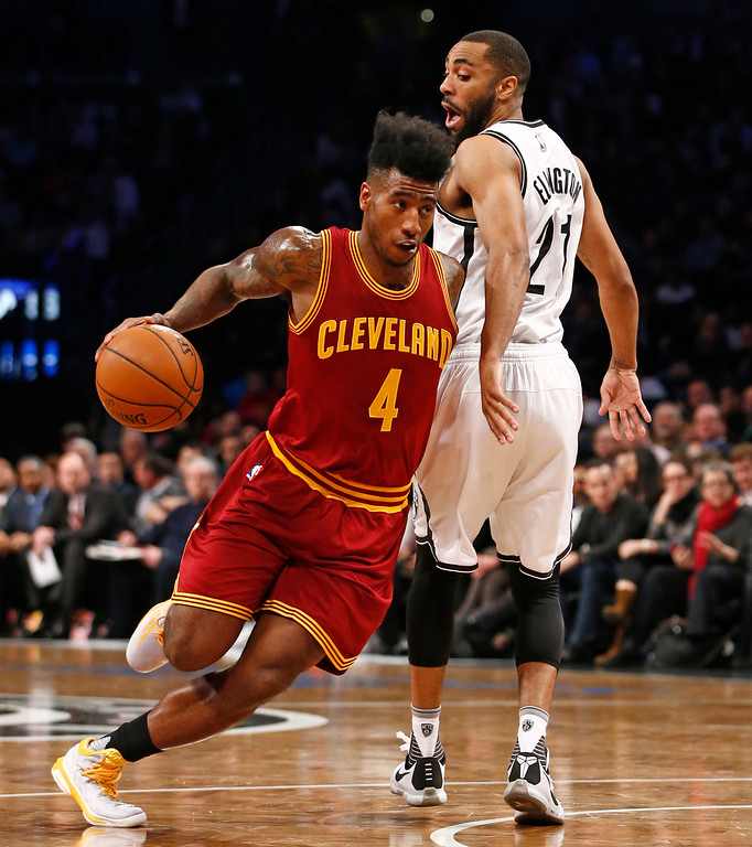 . Cleveland Cavaliers guard Iman Shumpert (4) drives around Brooklyn Nets guard Wayne Ellington (21) in the first half of an NBA basketball game, Wednesday, Jan. 20, 2016, in New York. (AP Photo/Kathy Willens)