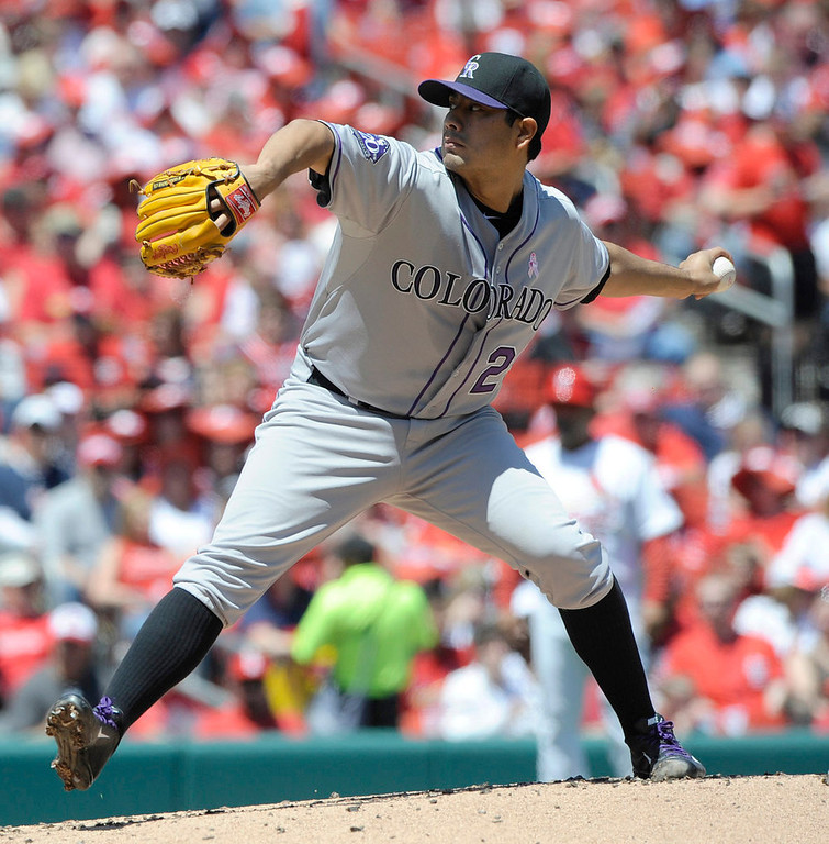 . Colorado Rockies\' starting pitcher Jorge De La Rosa throws against the St. Louis Cardinals in the first inning in a National League MLB baseball game Sunday, May 12, 2013, at Busch Stadium in St. Louis. (AP Photo/Bill Boyce)