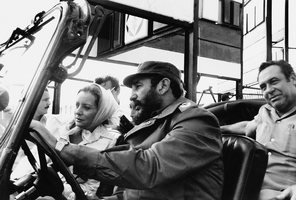 ". FILE - This June 6, 1977 file photo shows ABC news correspondent Barbara Walters, left, being driven by Cuban leader Fidel Castro on a sightseeing tour in Cuba.  On Friday, May 16, 2014, capping a spectacular half-century run she began as the so-called ""Today\"" Girl, Walters will exit ABC\'s \""The View.\"" Behind the scenes she will remain as an executive producer of the New York-based talk show she created 17 years ago, and make ABC News appearances as events warrant and stories catch her interest.  (AP Photo/ABC, File)"