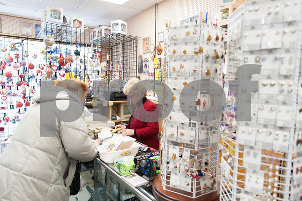 12/18/17 Wesley Bunnell | Staff Earrings for sale at the Quo Vadis gift shop on Broad St in Little Poland on Monday afternoon. Owner Krystyna Ovara, R, helps a customer.