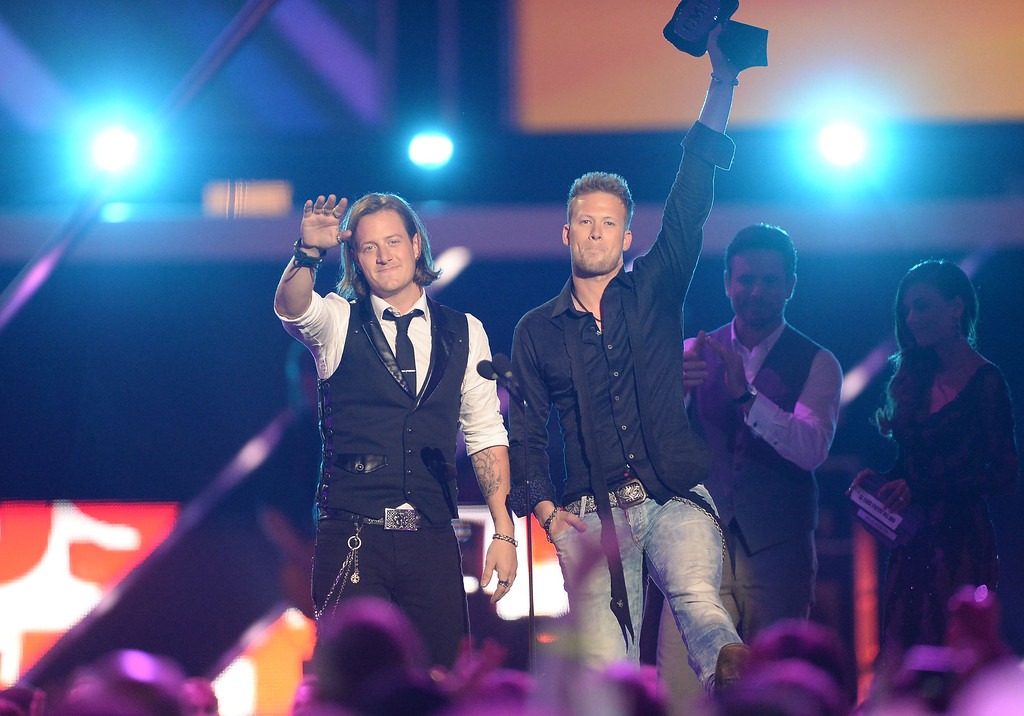 . NASHVILLE, TN - JUNE 05:  (L-R) Tyler Hubbard and Brian Kelley of Florida Georgia Line accept an award  onstage during the 2013 CMT Music awards at the Bridgestone Arena on June 5, 2013 in Nashville, Tennessee.  (Photo by Jason Merritt/Getty Images)