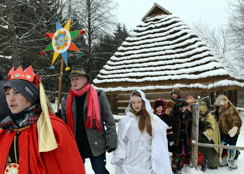 . Costumed children singing carols walk in the western Ukrainian city of Lviv during celebration of the Orthodox Christmas  on January 7, 2012. AFP PHOTO/ YURIY  DYACHYSHYN/AFP/Getty Images