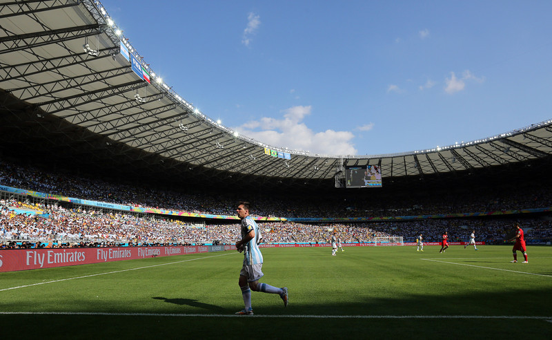 . Argentina\'s Lionel Messi jogs over to take a corner during the group F World Cup soccer match between Argentina and Iran at the Mineirao Stadium in Belo Horizonte, Brazil, Saturday, June 21, 2014. (AP Photo/Jon Super)