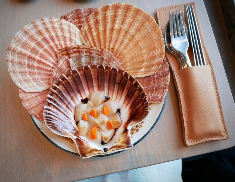 108: raw Norwegian scallop marinated in sourdough bread & rose hip seeds