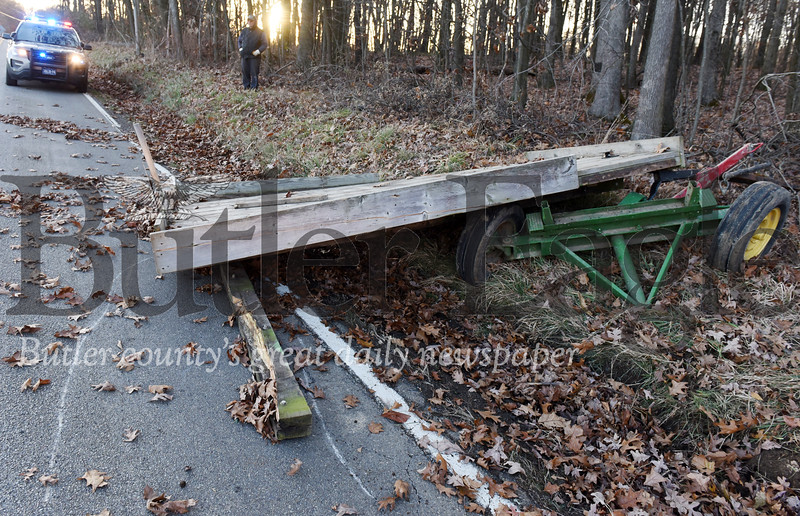 Harold Aughton/Butler Eagle: A woman was life flighted to a nearby hospital after the horse drawn wagon she was riding in was rear ended by car traveling west bond on North Washington Road, Sunday, Nov. 17, 2019.