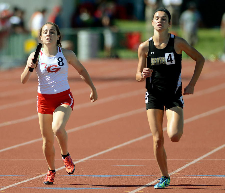 . Maribeth Joeright/MJoeright@News-Herald.com <p> Geneva\'s Emily Deering is edged out by Perrysburg in the finals of the Division I 4X800 finals during the state championship meet in Columbus,  June 6, 2014. Geneva took second place in the event.