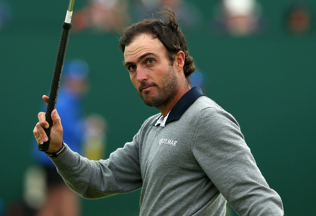 . Italy\'s Edoardo Molinari reacts on the 18th green during his fourth round 68, on the final day of the 2014 British Open Golf Championship at Royal Liverpool Golf Course in Hoylake, north west England on July 20, 2014.    ANDREW YATES/AFP/Getty Images