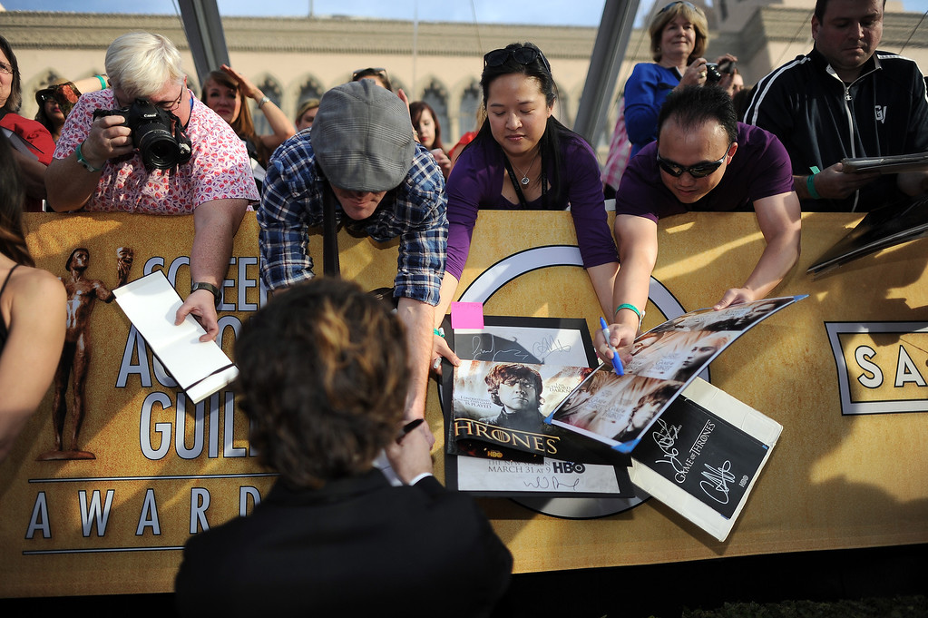 . Peter Dinklage signs autographs on the red carpet at the 20th Annual Screen Actors Guild Awards  at the Shrine Auditorium in Los Angeles, California on Saturday January 18, 2014 (Photo by Hans Gutknecht / Los Angeles Daily News)
