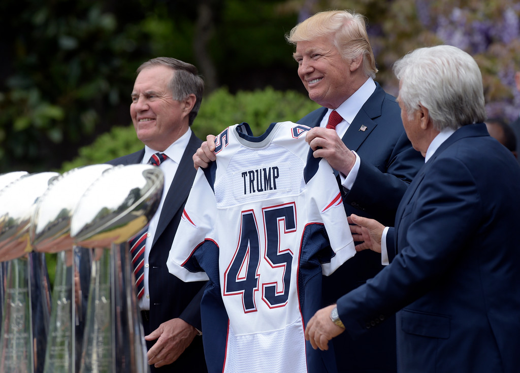 . President Donald Trump is presented a New England patriots jersey by Patriots owner Robert Kraft, right, and head coach Bill Belichick during a ceremony on the South Lawn of the White House in Washington, Wednesday, April 19, 2017, where the president honored the Super Bowl Champion New England Patriots for their Super Bowl LI victory. (AP Photo/Susan Walsh)
