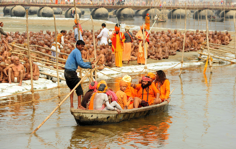 Description of . Newly initiated 'naga sadhus' prepare to perform rituals on the banks of the Ganga River during the Maha Kumbh festival in Allahabad on Febraury 6, 2013.   During every Kumbh Mela, the diksha - ritual of initiation by a guru - program for new members takes place.  Sanjay Kanojia/AFP/Getty Images