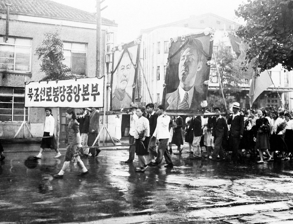 . Part of a welcome for the United States-Soviet commission on Korea on their arrival in Pyongyang, northern Korea, July 23, 1947 was this parade of Korean communists carrying huge portraits of Stalin and Kim IL Sung. The commission visited Pyong Yang, 165 miles north of Seoul, for the purpose of getting views of political groups on the prospecting. (AP Photo)