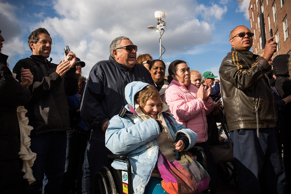 . LONG BEACH, NY - OCTOBER 25:  Citizens attend a ceremony to officially reopen the Long Beach boardwalk on October 25, 2013 in Long Beach, New York. The boardwalk was severely damaged by Superstorm Sandy last year, which killed 285 people and caused billions of dollars in damage. Long Beach\'s new boardwalk is made of Brazilian hardwood and is estimated to have a lifespan of 30-40 year; the previous boardwalk was only scheduled to last  three to seven years.  (Photo by Andrew Burton/Getty Images)
