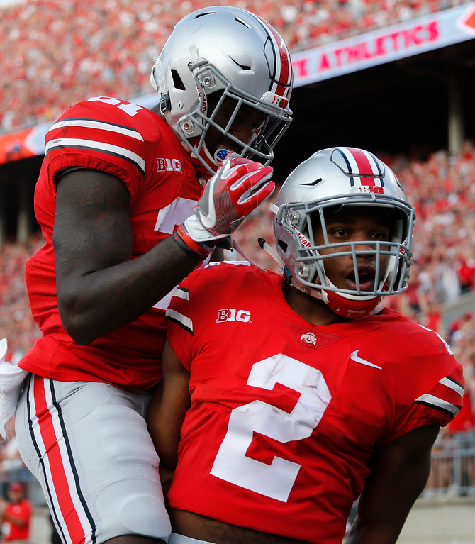 . Ohio State running back J.K. Dobbins, right, celebrates his touchdown against Army with teammate Parris Campbell during the second half of an NCAA college football game Saturday, Sept. 16, 2017, in Columbus, Ohio. Ohio State beat Army 38-7. (AP Photo/Jay LaPrete)