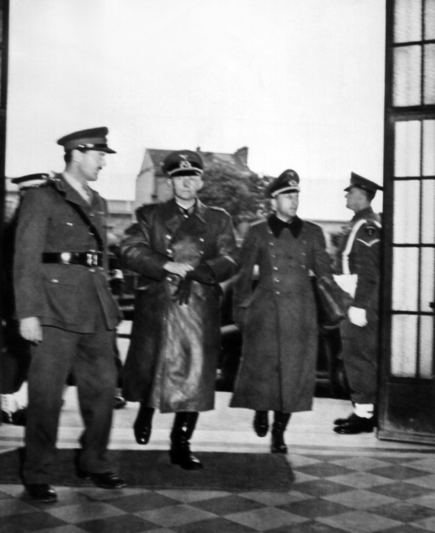 . Col. Gen. Gustaf Jodl (second from left) German chief of staff and his aide, Maj. Wilhelm Oxenius (second from right) arrive at SHAEF (Supreme Headquarters Allied Expeditionary Force) forward headquarters at Reims, France on May 7, 1945, to discuss terms of German surrenders. Others in picture are not identified.  (AP Photo/Pool/Life)