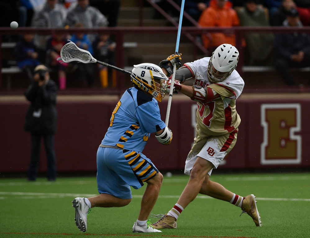 . Denver Pioneers Colin Woolford #57 winds up and shoots a shot against Marquette Golden Eagles B.J. Grill #8 in the first quarter during the Big East Championship game at Peter Barton Stadium May 07, 2016. (Photo by Andy Cross/The Denver Post)