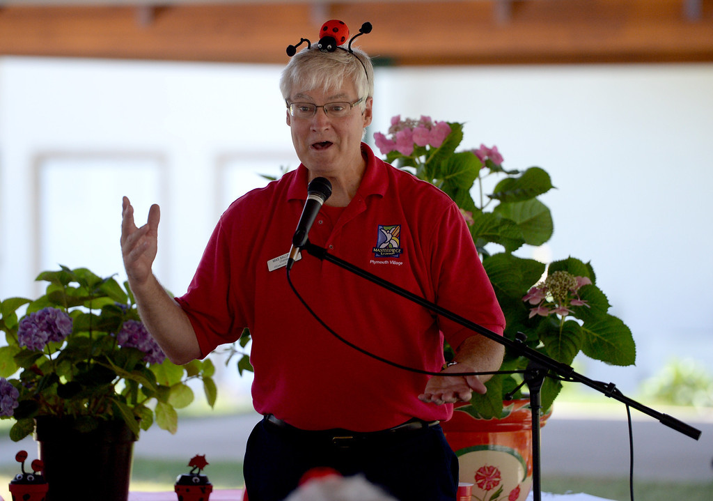 . Chaplain Mike Ballinger entertains the crowd during the 4th annual Grove Ladybug Release party at Plymouth Village in Redlands, Ca., Thursday, June 12, 2014. The Grove at Plymouth Village in Redlands, held its annual Ladybug Release party, letting thousands of the beetles go at the senior living retirement community. (Photos by John Valenzuela/ Redlands Daily Facts)