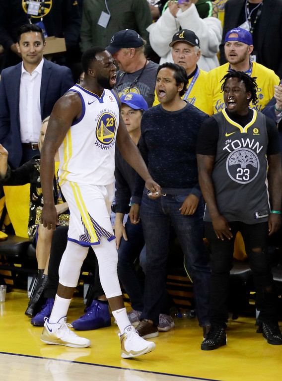 . Golden State Warriors forward Draymond Green (23) celebrates in front of fans during the first half of Game 1 of basketball\'s NBA Finals between the Warriors and the Cleveland Cavaliers in Oakland, Calif., Thursday, May 31, 2018. (AP Photo/Marcio Jose Sanchez)