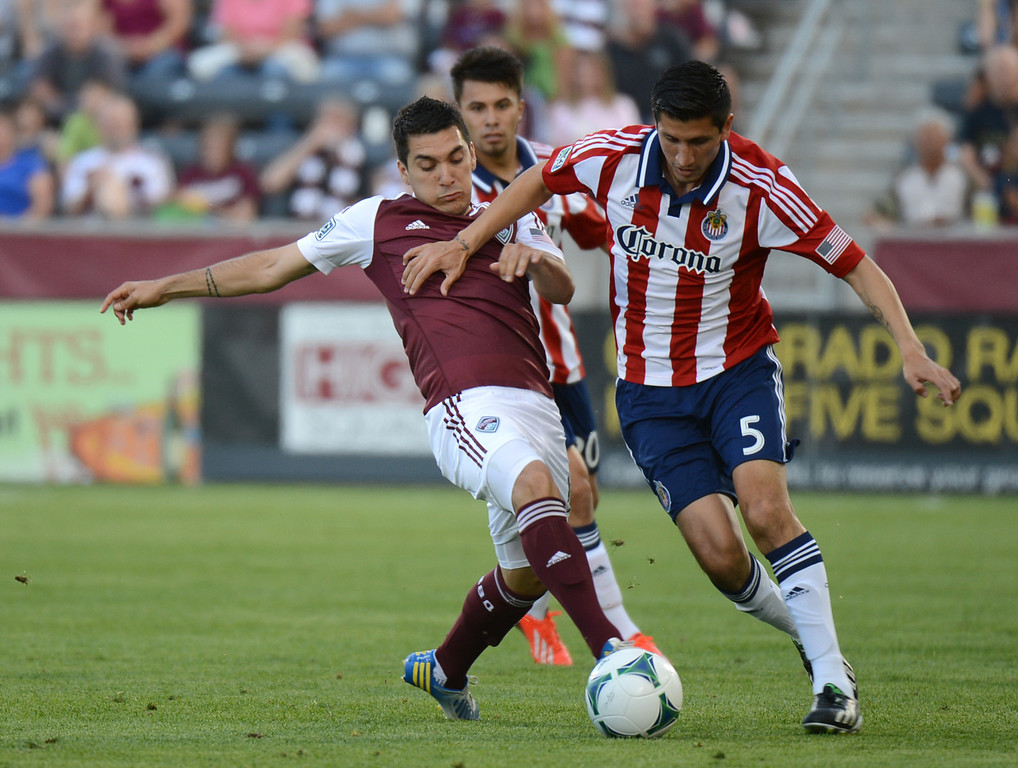 . COMMERCE CITY, CO. - MAY 25: Martin Rivero of Colorado Rapids (10) pressures Carlos Borja of Chivas USA (5) in the 1st half of the game at Dick\'s Sporting Goods Park. Commerce City, Colorado. May 25, 2013. (Photo By Hyoung Chang/The Denver Post)