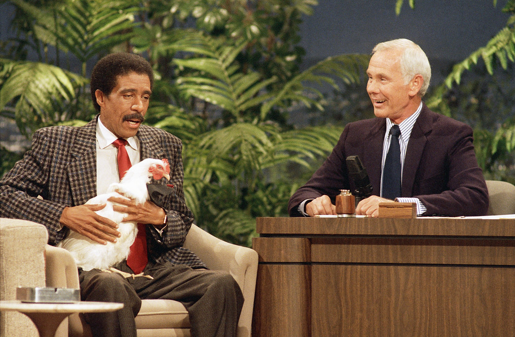 ". Richard Pryor holds a chicken while speaking with Johnny Carson on ""The Tonight Show\"" at the NBC studio in Burbank, Calif., Oct. 9, 1986.  (AP Photo/Tweed)"