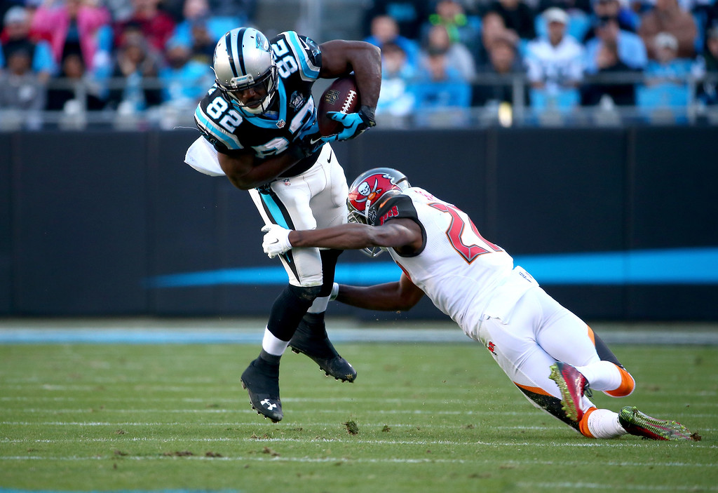 . CHARLOTTE, NC - DECEMBER 14:  Jerricho Cotchery #82 of the Carolina Panthers lunges for more yardage in the 2nd half against the Tampa Bay Buccaneers  during their game at Bank of America Stadium on December 14, 2014 in Charlotte, North Carolina.  (Photo by Streeter Lecka/Getty Images)