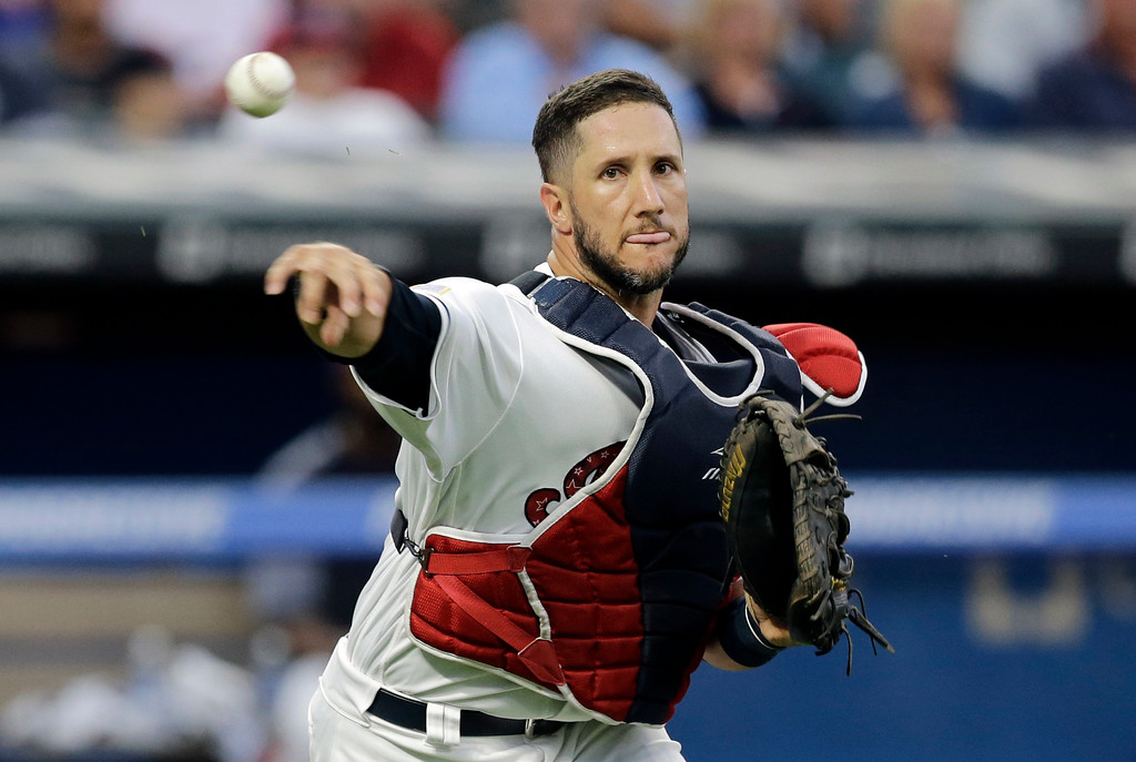 . Cleveland Indians\' Yan Gomes throws out San Diego Padres\' Manuel Margot at first base in the sixth inning of a baseball game, Tuesday, July 4, 2017, in Cleveland. (AP Photo/Tony Dejak)