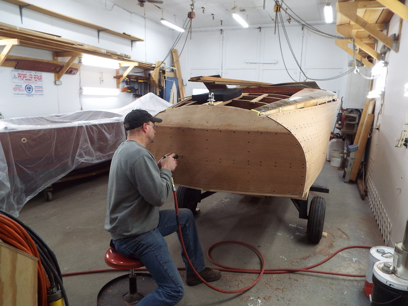 Drilling the transom for plugs.