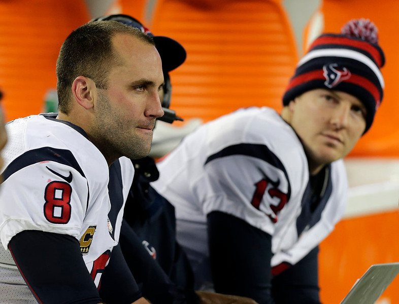. Houston Texans quarterback Matt Schaub, left, sits on the bench with back up quarterback T.J. Yates after throwing an interception pass during the second half of an AFC divisional playoff NFL football game against the New England Patriots in Foxborough, Mass., Sunday, Jan. 13, 2013. (AP Photo/Charles Krupa)