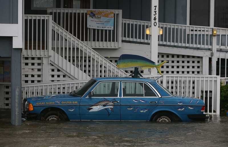 . A Mercedes sitting at restaurant on Hwy 64 is flooded by Hurricane Arthur, July 4, 2014 in Nags Head, North Carolina. Hurricane Arthur hit North Carolina\'s Outer Banks overnight causing wide spread power outages and minimal flooding and damage.  (Photo by Mark Wilson/Getty Images)