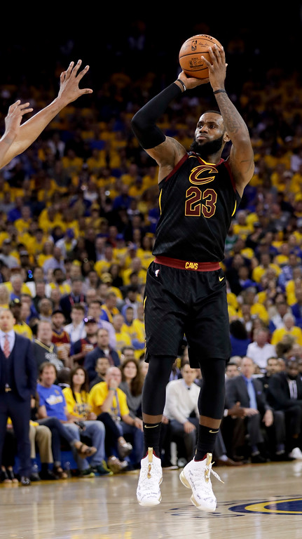 . Cleveland Cavaliers forward LeBron James (23) shoots against the Golden State Warriors during the second half of Game 1 of basketball\'s NBA Finals in Oakland, Calif., Thursday, May 31, 2018. (AP Photo/Marcio Jose Sanchez)