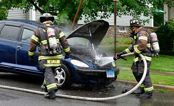 9/6/2019 Mike Orazzi | StaffrBristol firefighters extinguish a vehicle fire on George Street after it caught fire on Friday afternoon. No injuries were reported and the fire was put out quickly.