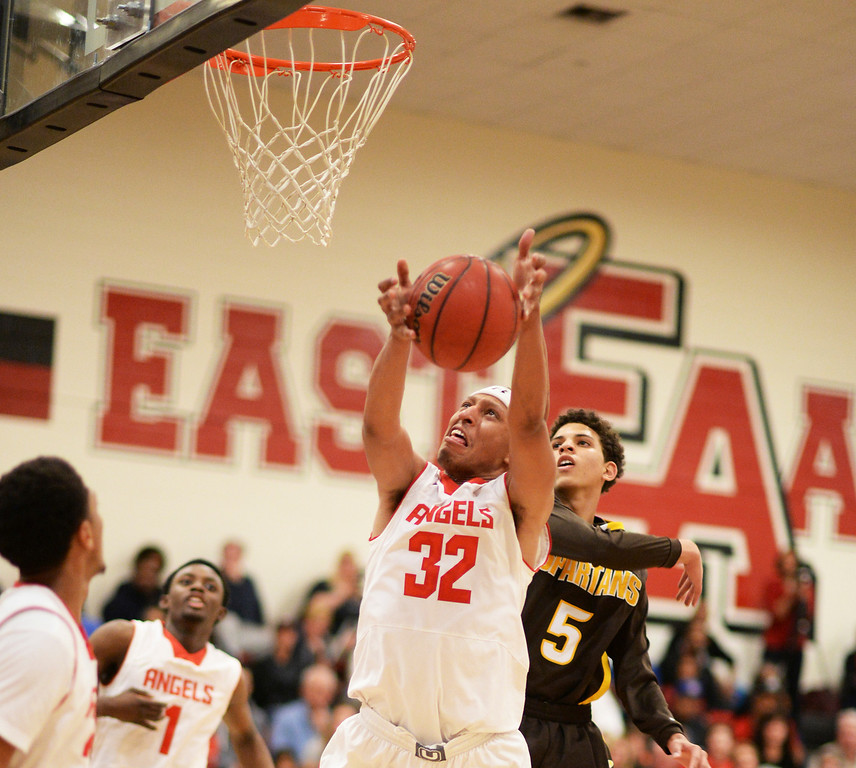 . DENVER, CO. JANUARY 24: Tyre Robinson of East High School (32) goes up for a basket at East High School in Denver, Colorado January 24, 2014. East High School won 91-62. (Photo by Hyoung Chang/The Denver Post)