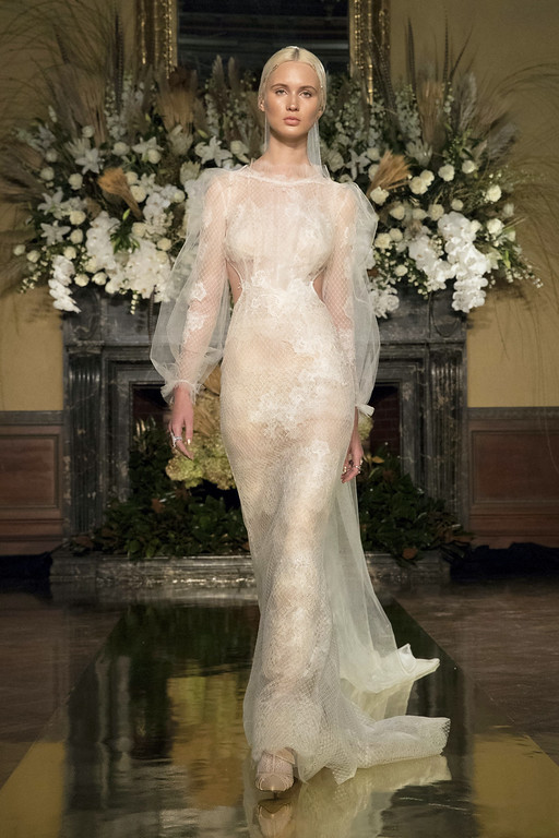 . In this Thursday, Oct. 6, 2016 photo, the YolanCris bridal collection is modeled during bridal fashion week in New York.  From boho chic to traditional ball gowns, models dressed as brides took Manhattan this month for a trade show of their very own following the fall cycle of womenswear runway around the globe. (AP Photo/Mary Altaffer)